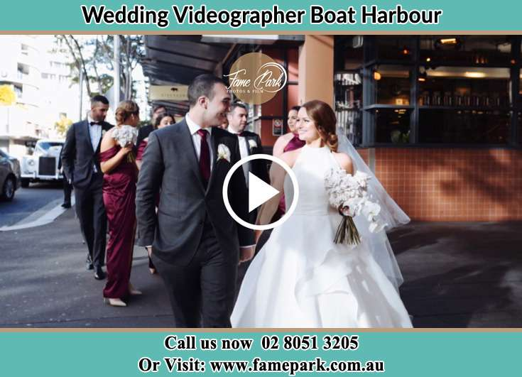The Groom and the Bride walking in the street Boat Harbour NSW 2316