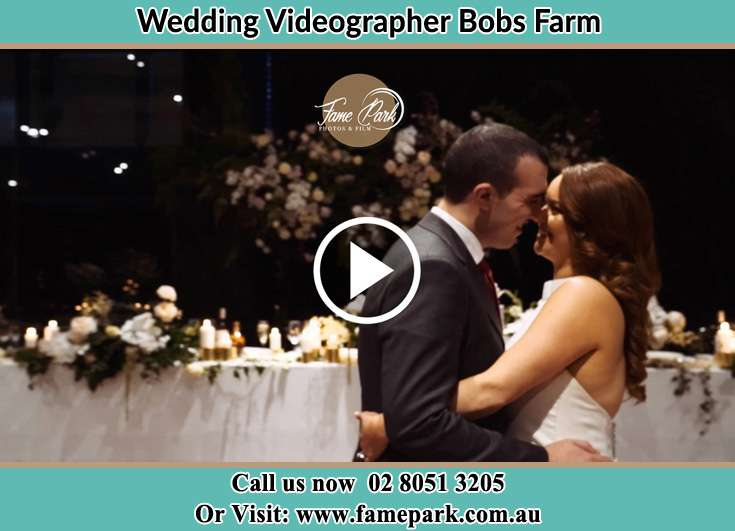 Bride and Groom looking at each other while dancing Bobs Farm NSW 2316
