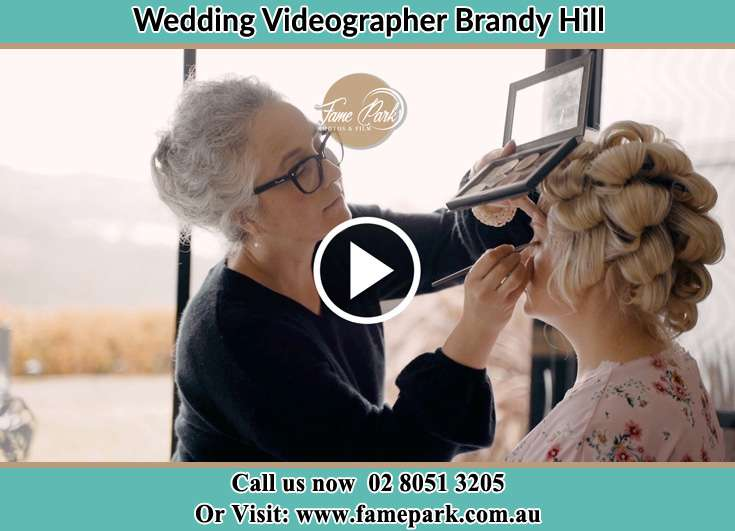 The Bride having a make-up with the help of the makeup artist Brandy Hill NSW 2324
