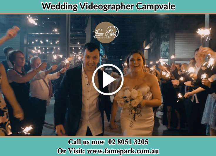 The newly weds walking through the well wishers Campvale NSW 2318