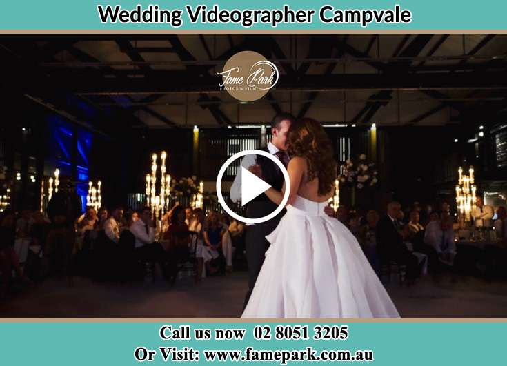 Bride and Groom looking at each other while dancing Campvale NSW 2318