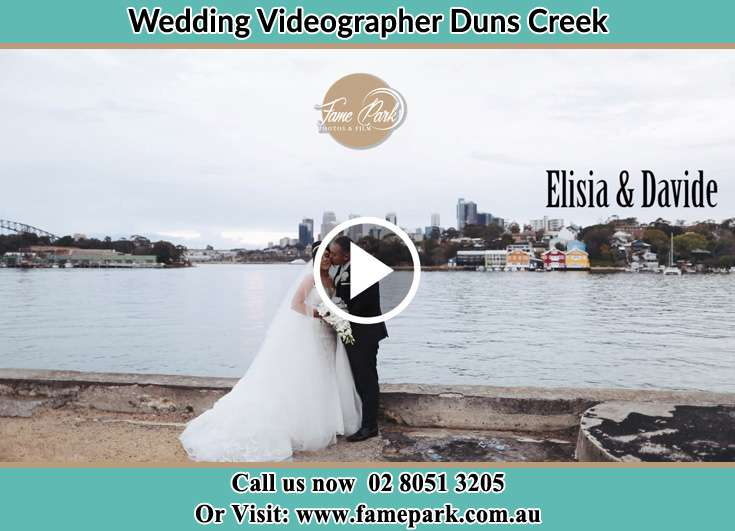 Bride and Groom kissed at the shore Duns Creek NSW 2321