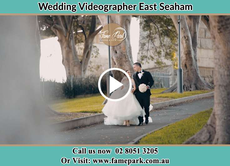 The Groom and the Bride walking in the street East Seaham NSW 2324