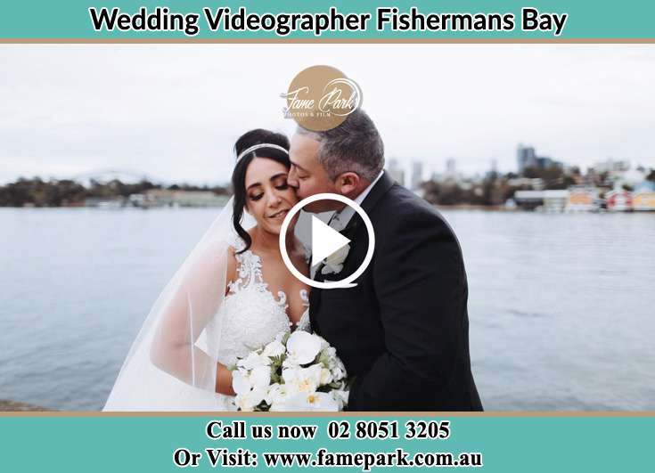 Bride and Groom kissed at the shore Fishermans Bay NSW 2316