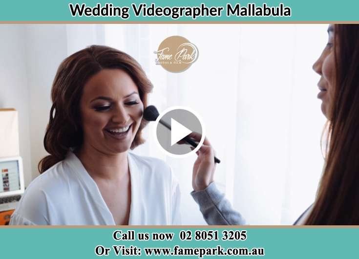 The Bride having a make-up with the help of the makeup artist Mallabula NSW 2319