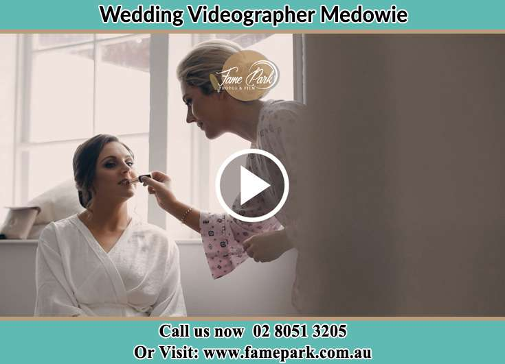 The Bride having a make-up with the help of the makeup artist Medowie NSW 2318