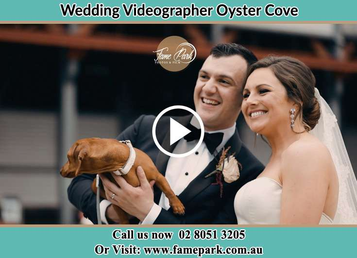 The new couple posed for the camera with their dog Oyster Cove NSW 2318