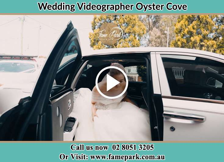 The Bride going out form the wedding car Oyster Cove NSW 2318
