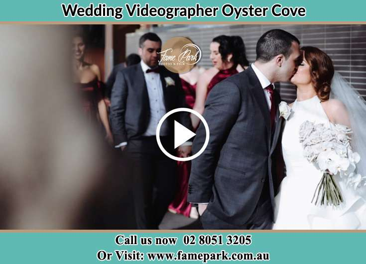 The newly weds kissing Oyster Cove NSW 2318