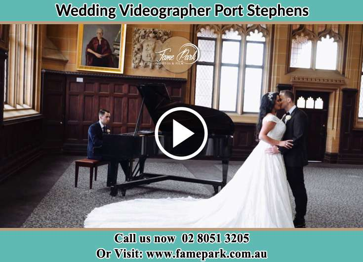 The Groom and the Bride dancing with the pianist playing Port Stephens