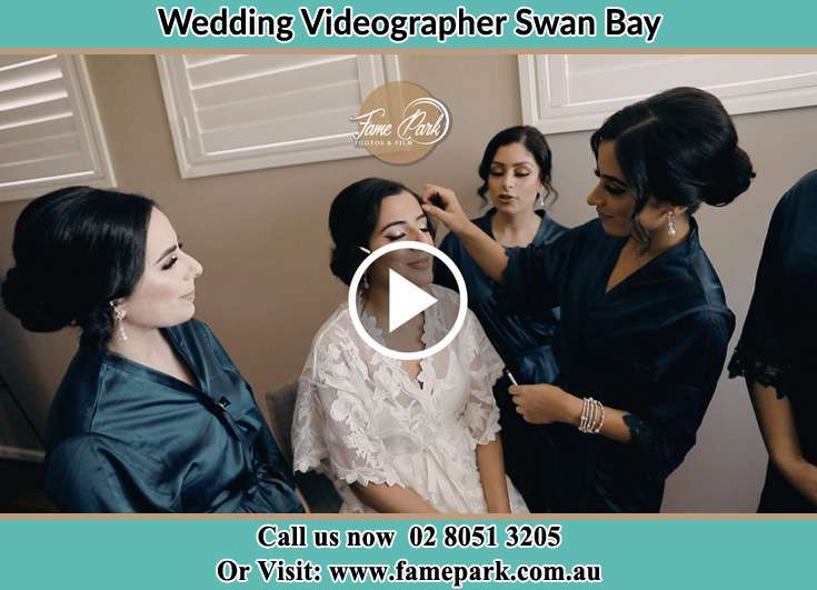 The Bride having a make-up with the help of the makeup artist Swan Bay NSW 2324