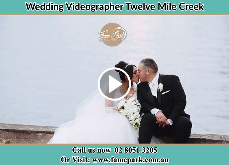 Bride and Groom kissed at the shore Twelve Mile Creek NSW 2324