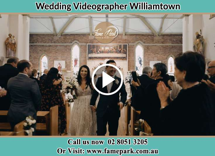 The newly weds walking through the well wishers Williamtown NSW 2318