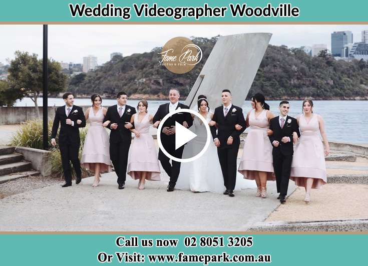 The Bride and the Groom with the entourage near the shore Woodville NSW 2321
